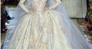 بالصور فساتين زفاف فخمه , اروع الفساتين للعرائس الجميله 980 14 310x165